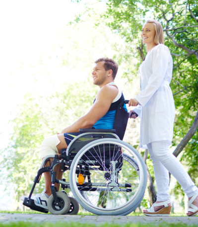 woman assisting man on wheelchair