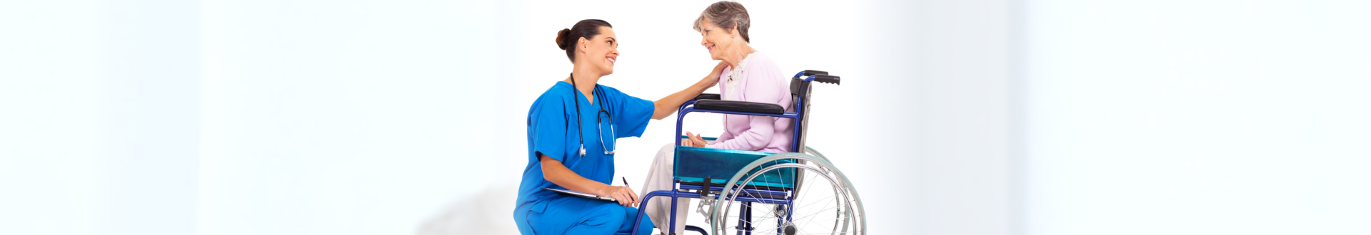 female medical staff with senior woman on wheelchair smiling