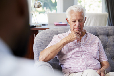 senior man having counseling with his psychologist